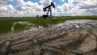 A Tundra Oil & Gas well near Pierson is surrounded by water. Flooding has shut down up to 85 per cent of the wells in Waskada-Pierson, the province said.