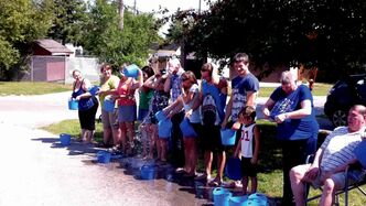 Participants douse themselves in ice water.