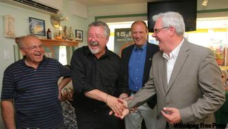 Albert Kokonos (left) and NDP candidates Jim Murray (beside Kokonos) and Drew Caldwell joined NDP Leader Greg Selinger (right) at Kokonos's Albert's Bistro in Brandon on Sunday. Selinger announced the NDP plans to eliminate taxes for small businesses by increasing the small-business income limit.