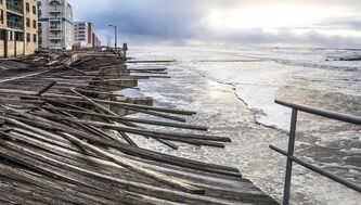 In this Oct. 30, 2012 photo provided by the photographer, waves crash onto the battered boardwalk in Long Beach, N.Y., the morning after Superstorm Sandy struck.Tisi-Kramer's Long Island photo is one of 200 images of Sandy at an exhibition at the Museum of the City of New York.