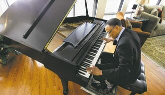 Lewis plays  at his home  in Chicago.  He performs Friday at  the Burton  Cummings Theatre during the Winnipeg International  Jazz Festival.