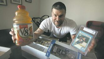Jeremy Regen with his stuff, V8 Juice, White T-shirt, Andrew Ladd Bobble Head, Hockey Cards.