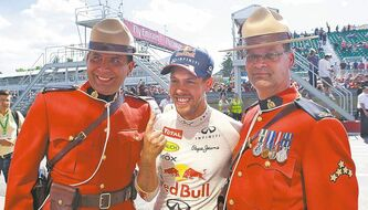 Canadian Grand Prix champion Sebastian Vettel celebrates with a pair of Mounties Sunday.