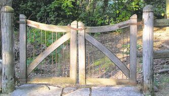 The timeless look of weathered cedar is well suited to a pair of classic handcrafted gates that lead to Carol Bergmann's cut flower garden south of St. Norbert.