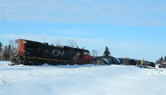 Several cars from a CN train derailed near Paynton, Sask., on Thursday, Jan. 24, 2013 following a collision with a road grader. THE CANADIAN PRESS/ho-RCMP