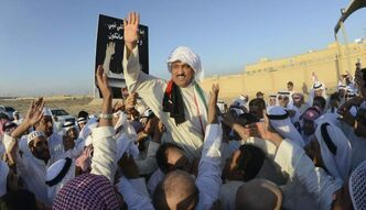 Former Islamist MP Musallam Al Barrak salutes supporters after being released from Kuwait's Central Prison in Sulaibiya, Kuwait on Thursday, Nov. 1, 2012.