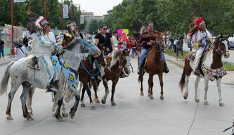 Some participants in the rally rode horses, wearing traditional Aboriginal dress.