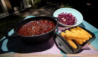 Baked beans, corn bread and red cabbage and apple slaw.