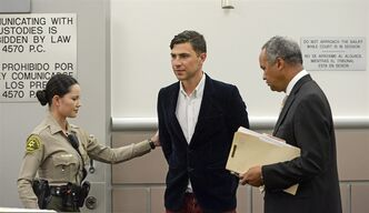 Vitalii Sediuk, from Ukraine, is led into the courtroom with his attorney Anthony Willoughby, right in Los Angeles Superior Court Friday, May 30, 2014, in Los Angeles. Sediuk faces four misdemeanor charges in connection with an alleged May 28 attack on actor Brad Pitt at a Los Angeles movie premiere. (AP Photo/Kevork Djansezian, Pool)