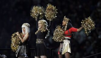 "FILE - In this Feb. 5, 2012 file photo, Madonna, center, performs with Nicki Minaj, left, and M.I.A. during halftime of the NFL Super Bowl XLVI football game between the New England Patriots and the New York Giants in Indianapolis. Madonna says she's not happy that M.I.A. made an obscene gesture during the Super Bowl halftime show. Madonna said on Ryan Seacrest's radio show Friday, Feb. 10, that the gesture was pointless and ""seemed out of place."" The British hip-hop artist, invited by Madonna to participate in Sunday's halftime show in front of 114 million people, extended her middle finger to the camera."