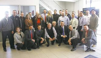 Vickar Chev president Larry Vickar (front row, centre left) and dealer principal Sam Vickar (front row, centre right) and the dealership's sales team.