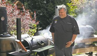 "Ted Reader, author of the recent book ""Gastro Grilling"" fires up a charcoal grill in Toronto on Wednesday May 15, 2013. THE CANADIAN PRESS/Chris Young"