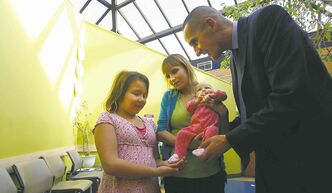 Wayne Glowacki / Winnipeg Free PressStephanie Hall with daughters Emily and baby Ocean. Kevin Chief, minister of children, wants to get the word out about the importance of prenatal care and where services are available.