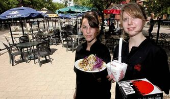 Servers Samantha Mauws (l) and Ava Glendinning on the patio at the Line-Up which offers a great view of the Exchange stage.