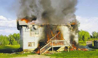 An empty house burns down on Bloodvein First Nation in June 2012. Two girls were charged.