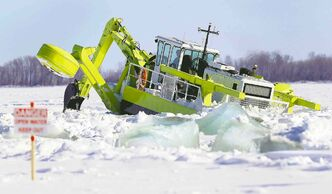 One of three Amphibex icebreaking machines heads out on the Red River north of Selkirk Tuesday morning in an effort to reduce the threat of ice jams later.