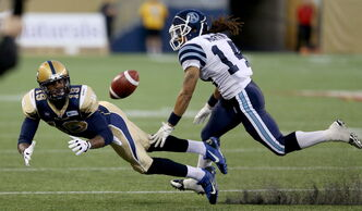 Bombers wide receiver Aaron Kelly dives for a pass in a preseason game.