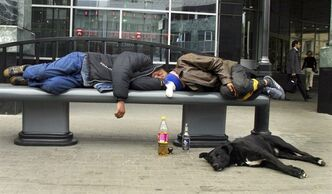 "FILE - In this Sept. 2005 file photo, men sleep after drinking on a bench in downtown Moscow. Russian men who down large amounts of vodka _ and too many do _ have an ""extraordinarily"" high risk of an early death, a new study says. The risk of dying before age 55 for those who said they drank three or more half-liter bottles of vodka a week was a shocking 35 percent. (AP Photo/Alexei Sazonov, File)"