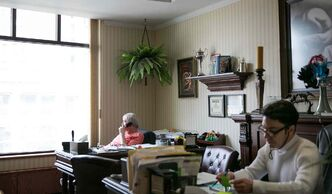 Rick Irving, and his business partner Mitch Fillion, managers of Superb Entertainment Agency, in their office in the White House on Portage Avenue.