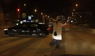 A pedestrian is dressed for the weather as he crosses Portage Avenue at Arlington Street this morning.