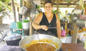 Nena sells jam at her open-air kitchen, on the road from Montezuma to Playa Carmen.