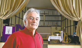 Roch Ouellet, brother of Cardinal Marc Ouellet, viewed as a contender for the papacy, is seen in the church Friday, March 1, 2013 in La Motte, Que.