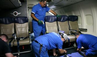 In this Sept. 23, 2013 photo, Southwest Airlines aircraft technicians install newer, skinnier seats on a 737 at the carrier's headquarters in Dallas. Southwest says passengers will have the same amount of legroom even though the new seats allow for another row onboard. (AP Photo/John Mone)