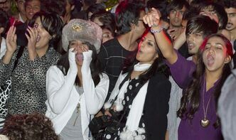 In this photo taken Saturday, Oct. 29, 2011, fans of Pakistani rap singer Adil Omar cheer during his concert in Islamabad, Pakistan. Omar was a 16-year-old rapping in his bedroom in Pakistan when a member of the American group Cypress Hill discovered his music on the Internet and invited him out to Los Angeles to record together. That was four years ago, and Omar has now recorded songs with several other American rappers, including Everlast from House of Pain, Xzibit and one of the members of Limp Bizkit. He plans to release his first album next year and has established himself as Pakistan's biggest _ and perhaps only _ rap star. (AP Photo/Anjum Naveed)