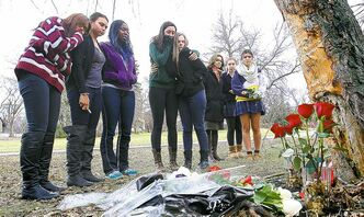 Friends and schoolmates grieve at the crash site.