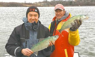Tim Au and Don Lamont with a couple of walleye caught this past week on a blustery Traverse Bay.