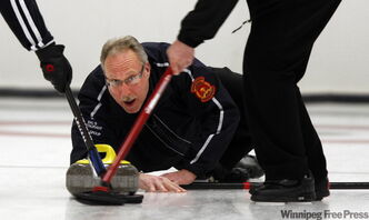 Kevin Larson puts the button in his sights during the Free Press event final at the Fort Rouge Curling Club on Monday night.