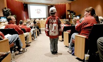 Young hockey fan Logan Wade, 7, addresses Glendale council Tuesday after Coun. Phil Lieberman announced his support for keeping the Coyotes in Arizona.