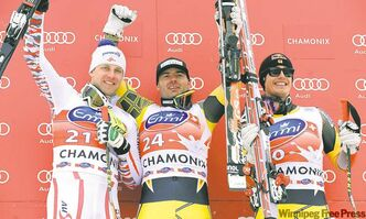 Canada�s Jan Hudec, center, winner of an alpine ski, men�s World Cup downhill, celebrates on the podium with second placed Austria�s Romed Baumann, left, and third placed Canada�s Erik Guay, in Chamonix, France, Saturday, Feb. 4, 2012. (AP Photo/Mario Curti)