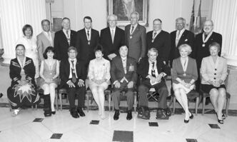 Back row, from left: Crystal Kolt, Bob Silver, Randy Moffat, Mark Chipman, Premier Greg Selinger, Al Simmons,  Brian Postl, Len Flett, Étienne Gaboury.  Front row from left: Leslie Spillett, Deborah Thorlakson, Art Miki,  Anita K. Lee, Lt.-Gov. Philip Lee, James Coyne, Pauline Clarke and Darlene Dziewit.