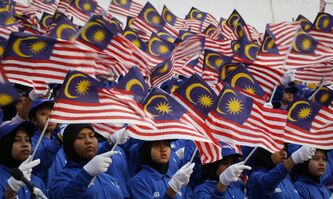 Malaysian students wave their national flags at rehearsal for Malaysia National Day celebrations at Independence Square in Kuala Lumpur, Malaysia, in August 2012.