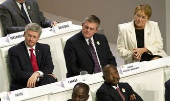 Prime Minister Stephen Harper, New Brunswick Premier David Alward and Quebec Premier Pauline Marois listen to speeches during the opening session at the Francophonie Summit in Kinshasa, Democratic Republic of Congo, Saturday, October 13, 2012. THE CANADIAN PRESS/Paul Chiasson