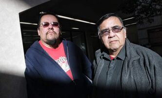 Buffalo Point First Nation band members, Elliott Cobiness (left) and Robert Kakaygeesick Jr. (right) think band chief, John Thunder, has gone too far by seeking an injunction that would make around 18 band members homeless if they don't stop a sit-in at the band's offices. On Friday it was announced that the injunction had been extended, but that protesters could return to their homes.