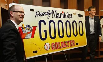 Andrew Collier, general manager of the Winnipeg Goldeyes (left) and  Justice Minister Andrew Swan unveiled the design of the new Winnipeg Goldeyes' specialty licence plate at Shaw Park Friday.