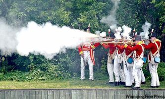 The Canadian Fencibles re-enact a skirmish in the War of 1812 at the Tay River Basin encampment at Perth, Ont.