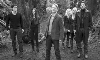 This film image released by Summit Entertainment shows, from left, Robert Pattinson, Kristen Stewart, Peter Facinelli, MyAnna Buring, Casey LaBow and Christian Camargo in a scene from