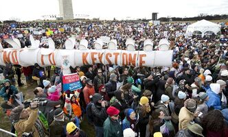 "Protesters gather at the National Mall in Washington calling on President Barack Obama to reject the Keystone XL oil pipeline from Canada, as well as act to limit carbon pollution from power plants and ""move beyond"" coal and natural gas, Sunday, Feb. 17, 2013. (AP Photo/Manuel Balce Ceneta)"