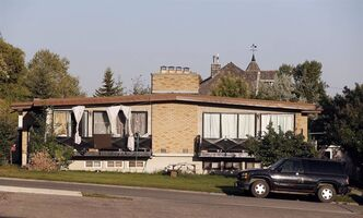 The Calgary duplex where Mario Antonacci lived is shown on July 24, 2013. THE CANADIAN PRESS/Jeff McIntosh