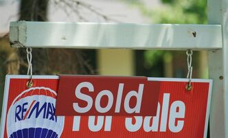 A sold sign in Oakville, Ont., Monday, July 23, 2012. THE CANADIAN PRESS/Richard Buchan