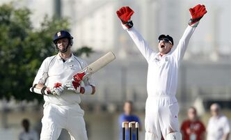 England's Steve Davies, right, appeals for LBW against Combined Xl cricket team player Boyd Rankin, left, during their match at the ICC Global cricket academy ground in Dubai, United Arab Emirates, Saturday, Jan. 7, 2012. (AP Photo/Aamir Shah)