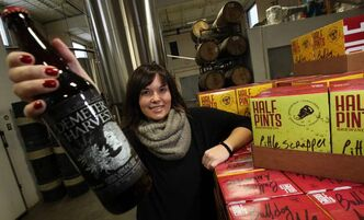 Nicole Barry of Half Pints Brewery in Winnipeg poses with some of their craft brewed product. Beer sales in Manitoba rose by 6.4 per cent in 2012.