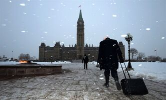 People make their way to the Centre Block of Parliament Hill in Ottawa on Monday, Jan. 28, 2013 as the House of Commons resumes following a six week break. THE CANADIAN PRESS/Sean Kilpatrick