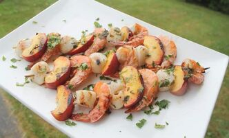 Grilled lemon garlic seabed and peach skewers