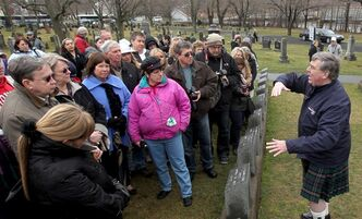 Tourists from the Titanic memorial cruise ship the Azamara Journey, take a guided tour of the Titanic graves in the Fairview Lawn cemetery in Halifax, Nova Scotia, on Thursday, April 12, 2012. The memorial cruise which departed from New York City, stopped in Halifax overnight, en route to the location were the Titanic sunk. In the days following the disaster, many of the deceased from the ill-fated ship were brought to Halifax for identification and burial. THE CANADIAN PRESS/Mike Dembeck