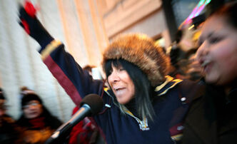 Buffy Sainte-Marie rallies protestors on the steps at the Manitoba Legislative Building Monday evening. Several hundred protestors gathered for a National Day of Protest as part of the Idle No More movement.