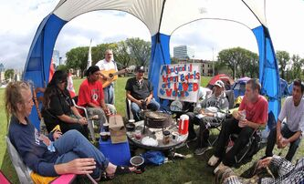 Protesters at a camp in Memorial Park say they won't leave until the prime minister calls an inquiry.